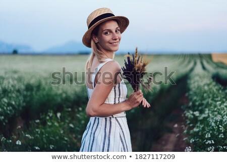 Ziemlich jungen Dame entspannenden duftenden Garten Stock foto © konradbak