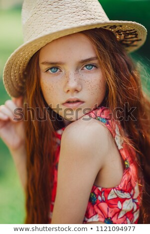 Beautiful young girl with red hair and green eyes Stock photo © Nejron