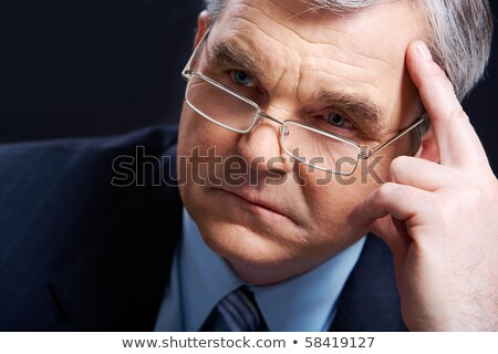 Senior employer thinking about something Stock photo © stockyimages