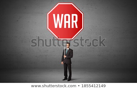 War Inscription on Warning Road Sign. Stock photo © tashatuvango