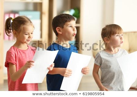Kórus gyerekek öt énekel együtt tart Stock fotó © Soleil