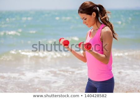 dumbbell concentrated biceps curl girl woman Stock photo © lunamarina