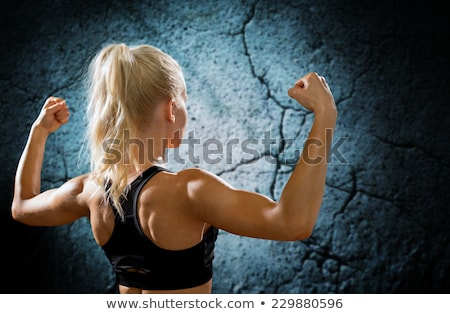 Athletic young woman showing muscles of the back stock fotó © restyler