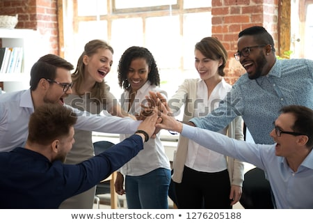 Teamwork of positive people. Concept of group of people collaboration and great work. stock photo © joseph_arce