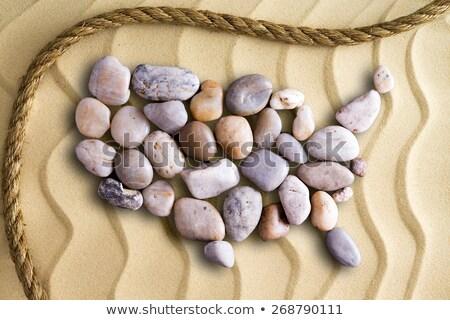 Pebble map of USA on decorative beach sand Stock photo © ozgur