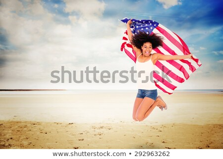 photos of girls jumping wrapped in american flag № 13410
