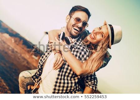 Sorridente belo casal ao ar livre parque Foto stock © deandrobot