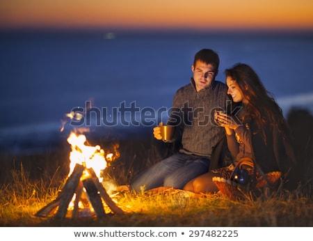 ストックフォト: 肖像 · 幸せな家族 · 座って · 火災 · 秋 · ビーチ