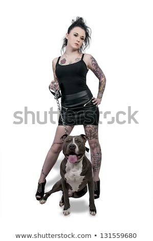 Stock photo: Tattooed Woman and bull terrier