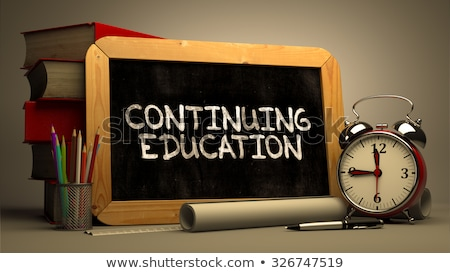 Foto stock: Hand Drawn Continuing Education Concept On Chalkboard