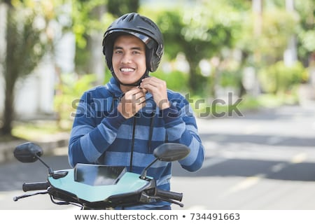Motorbike with a person wearing helmet  stock photo © shawlinmohd