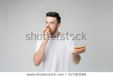 Men standing with hamburger and apple. Stock photo © RAStudio