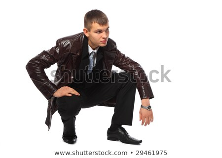 young businessman in leather jacket squats stock photo © paha_l