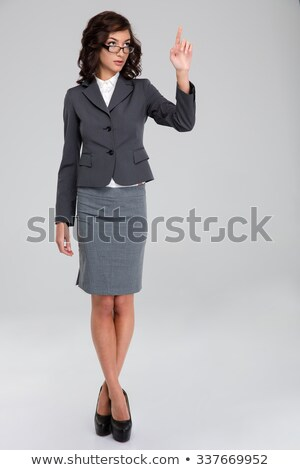 Confident business woman in glasses touching copyspace by finger Stock photo © deandrobot