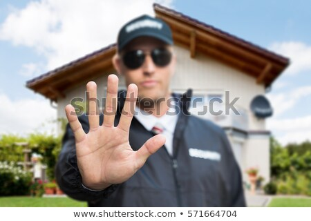 Security Guard Making Stop Gesture Outside Building Stock photo © AndreyPopov