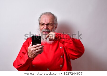 Stock photo: mature man looking at his smartphone