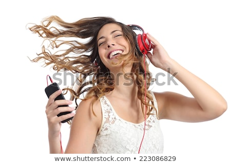 Happy active girl listening to music on smartphone app phone lifestyle Stock photo © Maridav