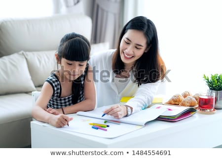 Chinese mother doing school homework with child Stock photo © Kzenon