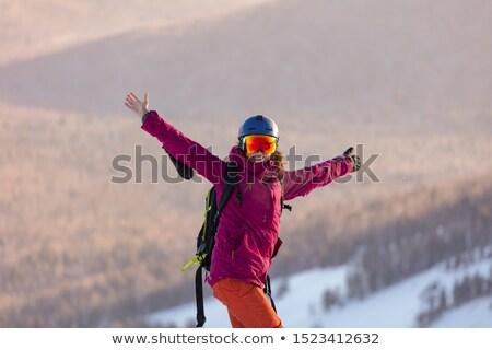 portrait of a happy young female skier stock photo © nobilior