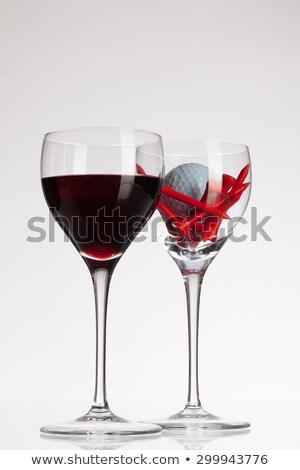 Сток-фото: мяч · для · гольфа · красный · стекла · таблице · столе · гольф