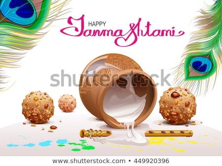 Holiday Symbols Krishna Janmashtami. Broken Pot of yoghurt, peacock feather, flute and sweets Stock photo © orensila