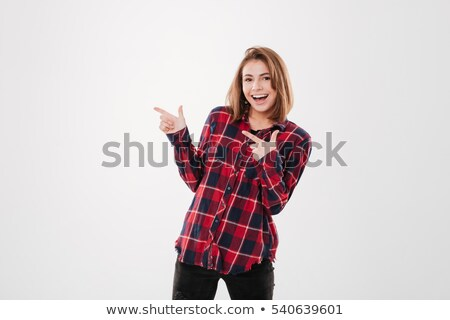 pretty young woman standing and pointing two fingers away stock photo © deandrobot