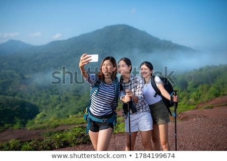 Woman hiker taking photo Stock photo © -Baks-