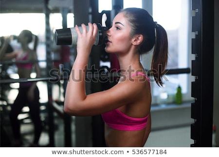 Stock photo: Fitness woman shakes press