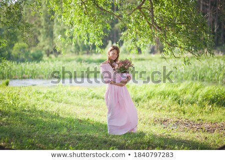gorgeous brunette beauty in a old fashioned dress in a forest stock photo © konradbak