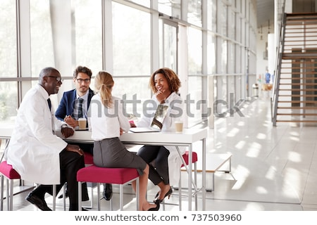 Modern fiatal üzletember visel szemüveg zsámoly Stock fotó © feedough