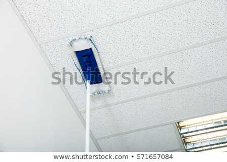 Mop Wiping On The Ceiling Of The House Stock photo © AndreyPopov