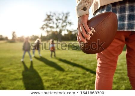 hermosa · femenino · americano · futbolista · casco · posando - foto stock © lightfieldstudios