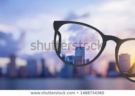 Glasses and a bright sky.