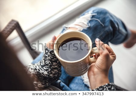 close up of woman holding hot tea cup Stock photo © dolgachov