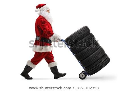 Car mechanic with tire Stock photo © Kurhan