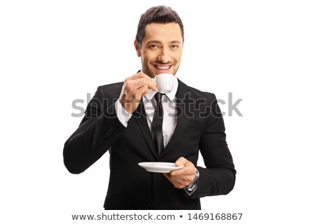 Young caucasian businessman holding cup of coffee. Stock photo © RAStudio