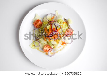Spice Mexican salad with meat and vegetables on white plate      Stock photo © Yatsenko
