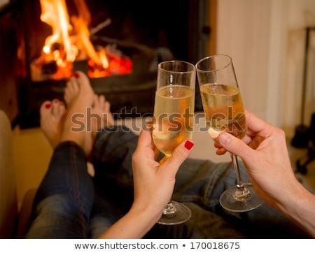 paar · woonkamer · drinken · champagne · glimlachend · man - stockfoto © deandrobot