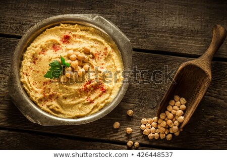 Hummus in metal bowl on  wooden table. Stock photo © user_10493298