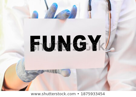 Fungi. Medical Concept on Blue Background. Stock photo © tashatuvango
