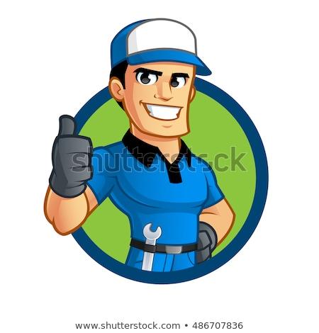 plumber or mechanic holding a spanner stock photo © krisdog