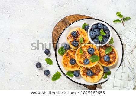 Túró palacsinták étterem sajt reggeli fehér Stock fotó © yelenayemchuk