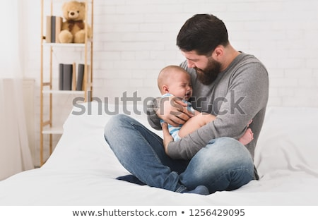 man comforting screaming baby Stock photo © IS2