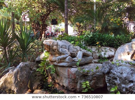 mexican iguana on sculpture in riviera maya stock photo © lunamarina