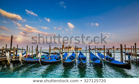 motion blurred traditional gondola boats in venice italy stock photo © dinga