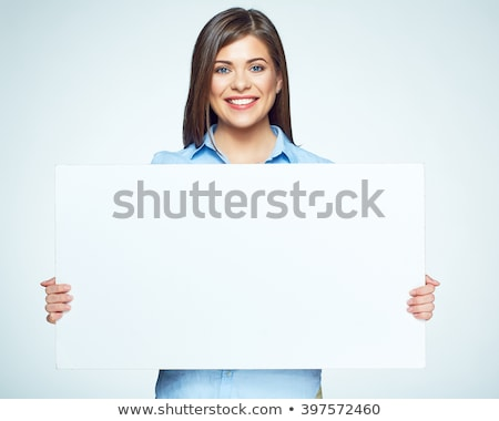 Stock photo: smiling young woman holding and showing big blank sign