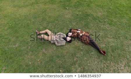 couple lying in field of high grasses Stock photo © IS2