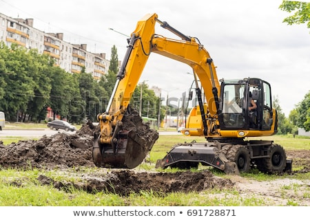 Bulldozer digging hole at the construction site Stock photo © bluering