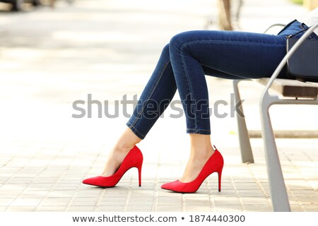 close up portrait of a female legs wearing high heels posing stock photo © deandrobot
