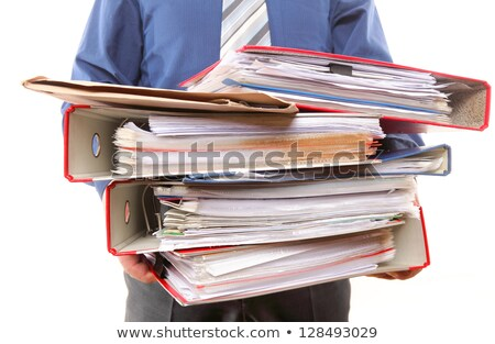 Man Carrying Pile Heavy Papers Stock photo © lenm